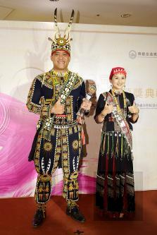 Maolin Elementary School director Omalizi Kumula, left, and Chang Yen, a teacher at the school, celebrate their students receiving the Best Traditional Album at the Golden Melody Awards for Traditional Arts and Music in Taipei on Saturday./ Photo cou