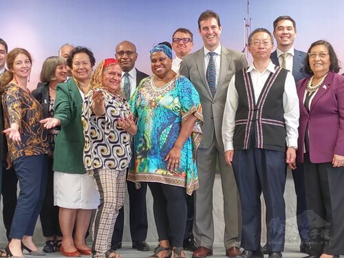 Joyce Bonner (first row, third left) and Leonora Adidi (first row, fourth left) take photo with other dignitaries the Australian Office in Taipei on Friday./Photo courtesy fo CNA
