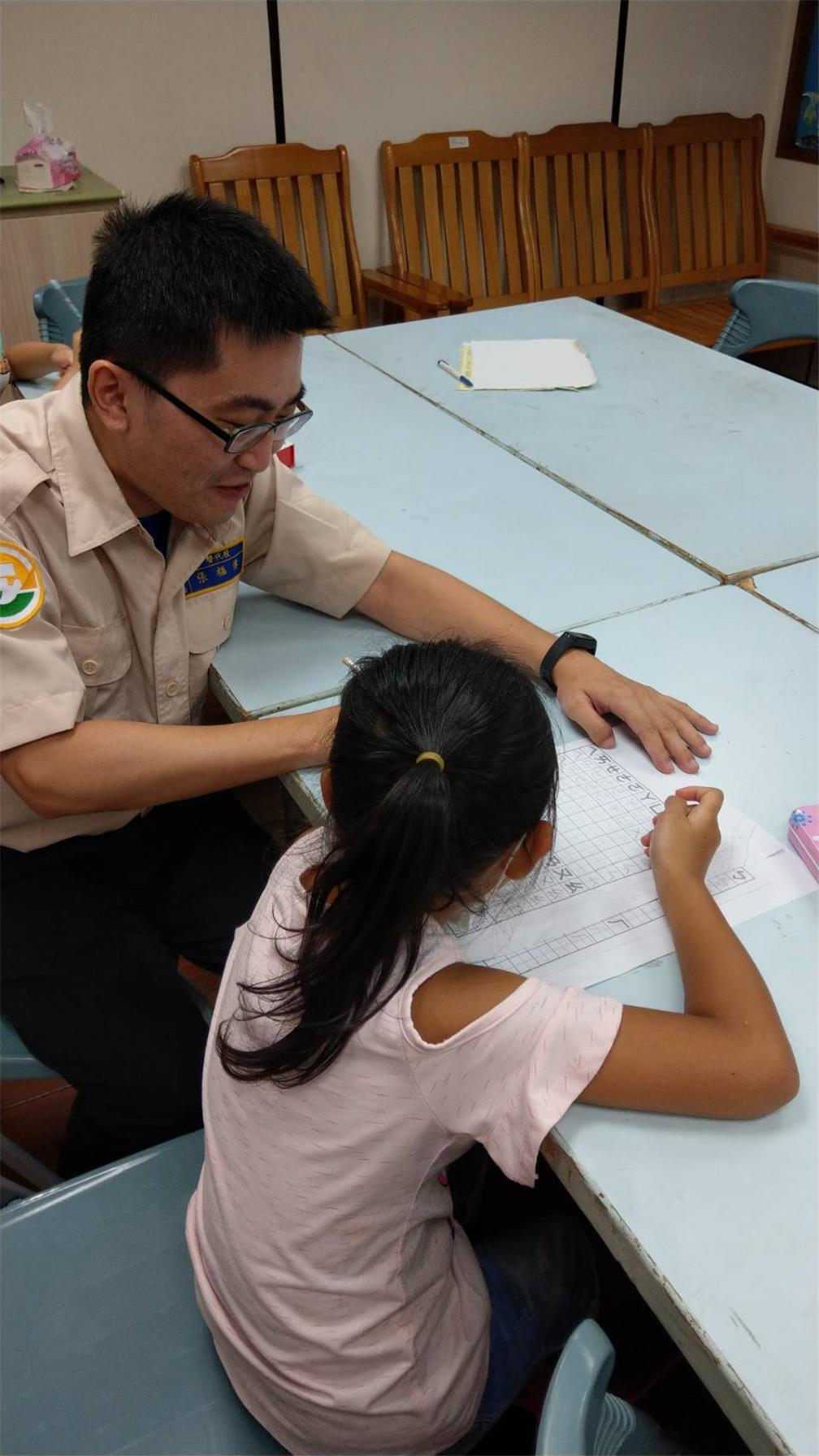 The draftees draw on their expertise to help the children with their assignments and learning activities.