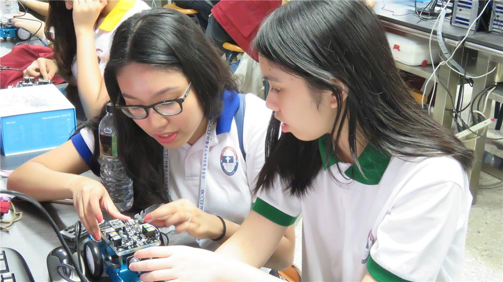 Young fellows from the Philippines assembled and installed the robots
