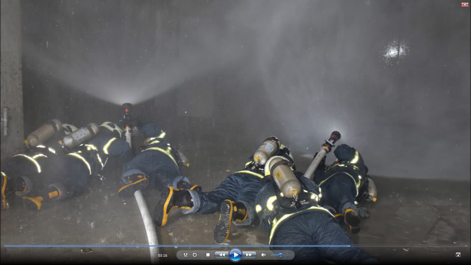 Trainees learn to contain the fire (a simulated drill).